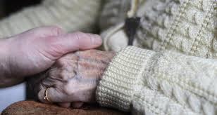holding hand of elderly person